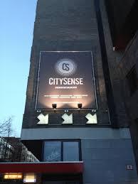 CitySense uithangbord op de gevel van het pand van The Courseware Company.